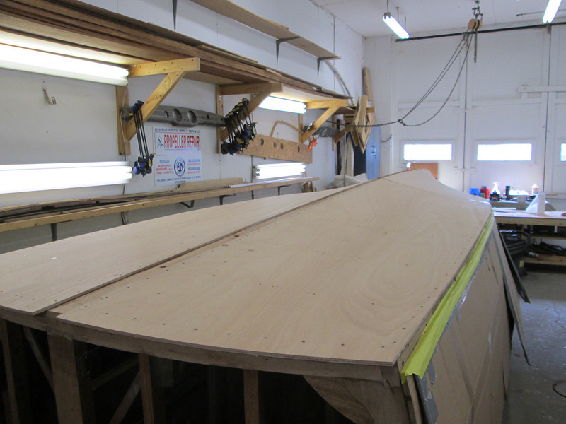 Rear port view of plywood installed with fasteners removed ready for the second layer of bottom.