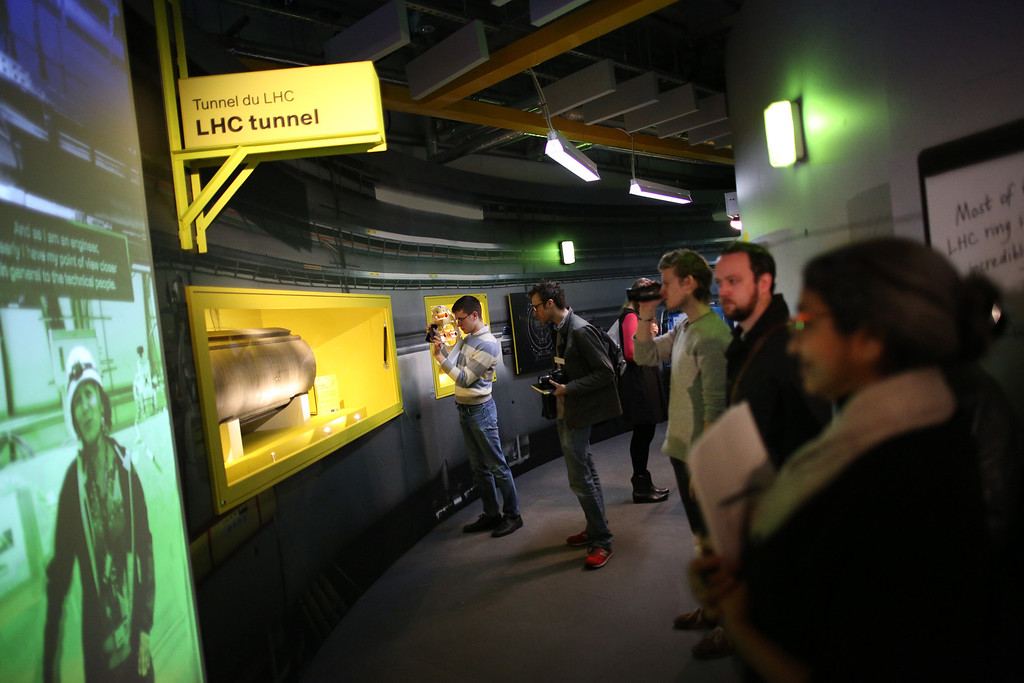. Visitors to the Science Museum stand in re-creation of part of the Large Hadron Collider (LHC)  at the \'Collider\' exhibition on November 12, 2013 in London, England.  (Photo by Peter Macdiarmid/Getty Images)