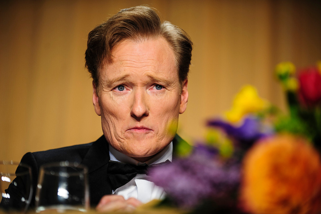 . WASHINGTON, DC - APRIL 27:  Comedian Conan O\'Brien looks into the audience during the White House Correspondents\' Association Dinner on April 27, 2013 in Washington, DC. The dinner is an annual event attended by journalists, politicians and celebrities. (Photo by Pete Marovich-Pool/Getty Images)