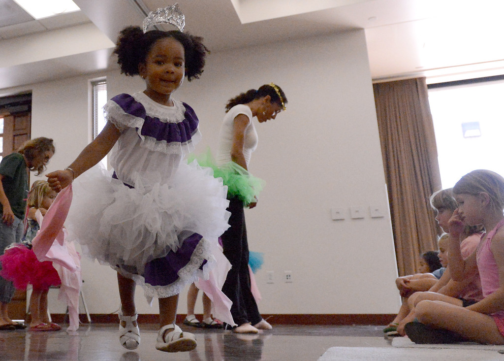 . Galyn Gorg shows kids dances from around the world during a dance showcase at the San Dimas Library Summer Reading Program June 26, 2013. (Thomas R. Cordova/Staff Photographer)