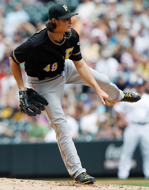 . Pittsburgh Pirates starting pitcher Jeff Locke works against the Colorado Rockies in the first inning a baseball game in Denver on Sunday, Aug. 11, 2013. (AP Photo/David Zalubowski)