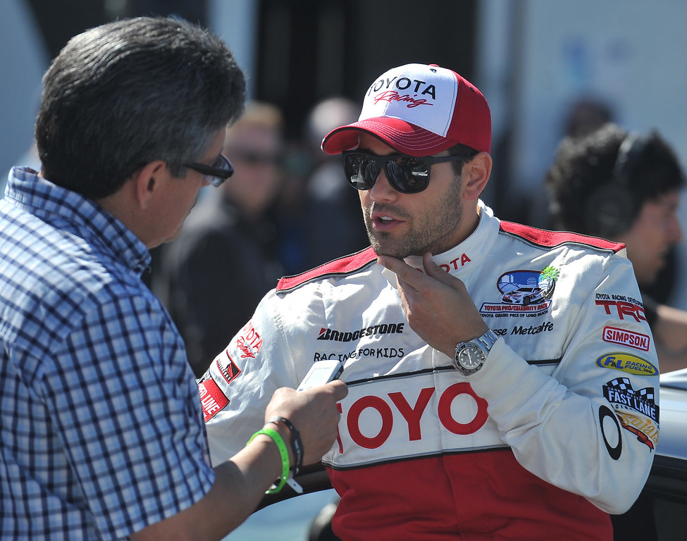 . 4/9/13 - Jesse Metcalfe gives an interview during media day for the 39th Annual Toyota Grand Prix of Long Beach. The celebrity/pro races spent the day practicing on the track, joking with their racing partners and giving interviews. Photo by Brittany Murray / Staff Photographer