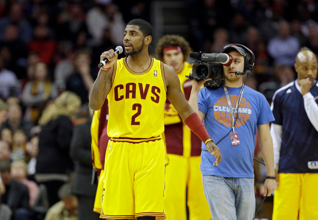 . Cleveland Cavaliers\' Kyrie Irving wishes fans a Happy Thanksgiving before an NBA basketball game against the Miami Heat Wednesday, Nov. 27, 2013, in Cleveland. (AP Photo/Mark Duncan)