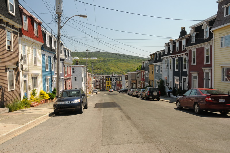 "I have enjoyed many tourism commercials celebrating the colourful streets of Newfoundland.  And I have most often referred to those colourful homes as ""M&M"" houses.  Well I was on the right track in terms of colour, but the adjective was a bit off.  The colour fronts are affectionately called ""Jelly Bean"" houses. And again you'll notice there is no grassy front yards, but people do tend to their plants."