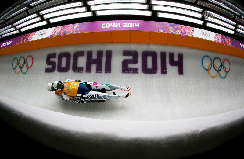 . Jinyong Park and Jung Myung Cho of South Korea makes a run during the Luge Relay on Day 6 of the Sochi 2014 Winter Olympics at Sliding Center Sanki on February 13, 2014 in Sochi, Russia.  (Photo by Alex Livesey/Getty Images)