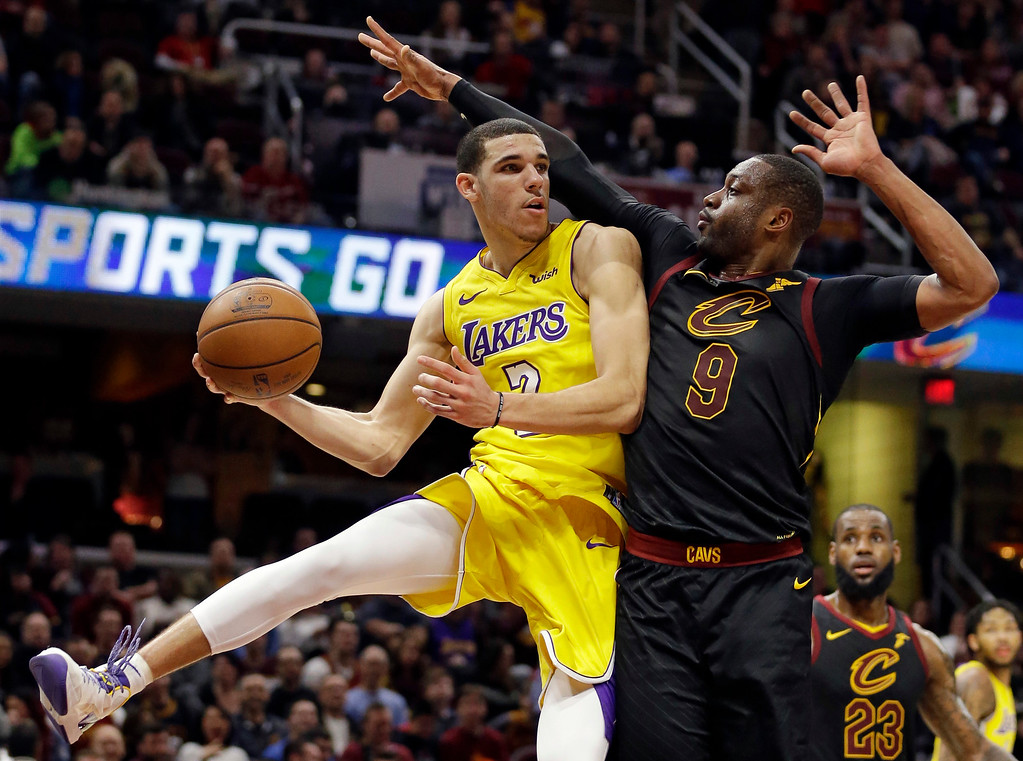 . Los Angeles Lakers\' Lonzo Ball (2) looks to pass against Cleveland Cavaliers\' Dwyane Wade (9) in the second half of an NBA basketball game, Thursday, Dec. 14, 2017, in Cleveland. (AP Photo/Tony Dejak)