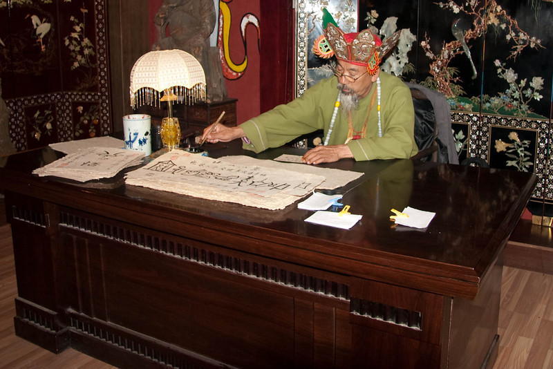 Donba priest, part of the Naxi group.  He can write in Chinese as well as pictograph.