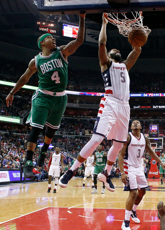 . Washington Wizards forward Markieff Morris (5) dunks next to Boston Celtics guard Isaiah Thomas (4) during the second half of Game 6 of an NBA basketball second-round playoff series, Friday, May 12, 2017, in Washington. The Wizards won 92-91. (AP Photo/Alex Brandon)