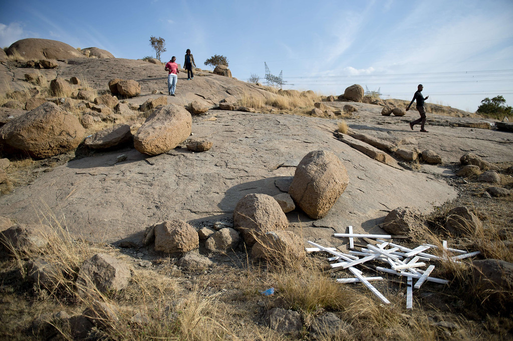 . Crosses are seen on July 9, 2013 at the bottom of the hill where 14 of 34 miners were killed by police during a strike in 2012 in the Nkaneng shantytown next to the platinum mine, run by British company Lonmin, in Marikana. On August 16, 2012, police at the Marikana mine open fire on striking workers, killing 34 and injuring 78, during a strike was for better wages and living conditions. Miners still live in dire conditions despite a small wage increase.  ODD ANDERSEN/AFP/Getty Images