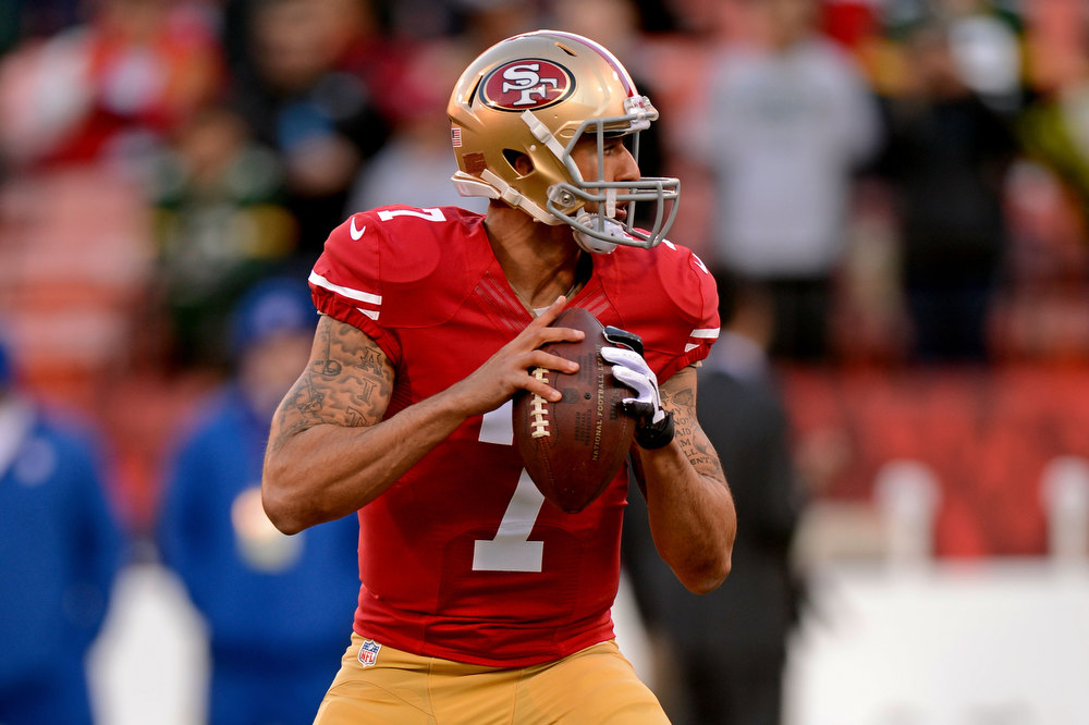 Description of . Quarterback Colin Kaepernick #7 of the San Francisco 49ers warms up prior to the NFC Divisional Playoff Game against the Green Bay Packers at Candlestick Park on January 12, 2013 in San Francisco, California.  (Photo by Thearon W. Henderson/Getty Images)
