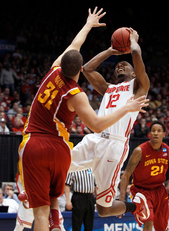 . Ohio State Buckeyes forward Sam Thompson (R) shoots over Iowa State Cyclones forward Georges Niang (L) during the second half of their third round NCAA tournament basketball game in Dayton, Ohio March 24, 2013.   REUTERS/Matt Sullivan