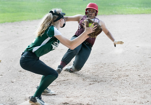 07/02/18 Wesley Bunnell | Staff New Britain vs Bristol district 5 softball tournament game at Rockwell Park on Monday evening. Kizbeth Ortiz (24) is tagged out by Bristol's Sophia Bouchard (12) at third base.