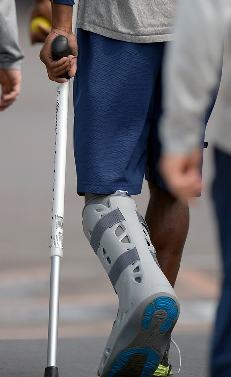 . Denver Broncos cornerback Champ Bailey walks to his rehab session during practice August 23, 2013 at Dove Valley. Bailey was wearing a walking boot cast and crutches. (Photo by John Leyba/The Denver Post)