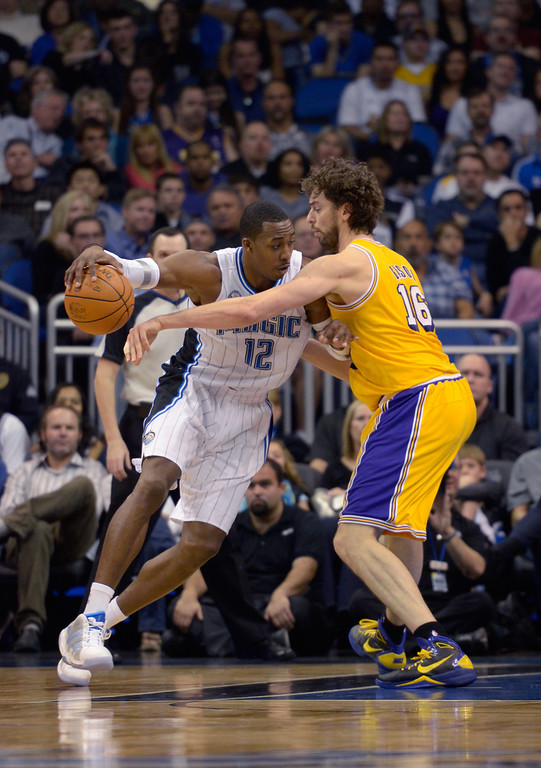 . Orlando Magic center Dwight Howard, left, drives into Los Angeles Lakers forward Pau Gasol during an NBA basketball game in Orlando, Fla., Sunday, Feb. 13, 2011.(AP Photo/Phelan M. Ebenhack)