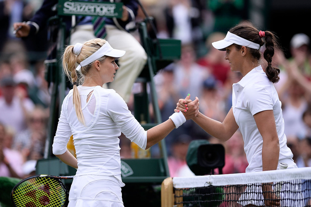 . Laura Robson of Great Britain shakes hands at the net with Maria Kirilenko of Russia following her victory in the Ladies\' Singles first round match on day two of the Wimbledon Lawn Tennis Championships at the All England Lawn Tennis and Croquet Club on June 25, 2013 in London, England.  (Photo by Dennis Grombkowski/Getty Images)