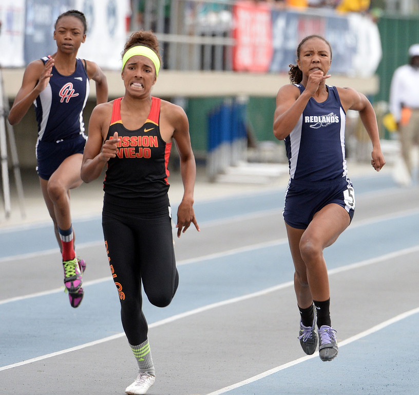 . Redland\'s Margaux Jones, right, finishes second in the division 2 200 meters race during the CIF Southern Section track and final Championships at Cerritos College in Norwalk, Calif., Saturday, May 24, 2014.   (Keith Birmingham/Pasadena Star-News)