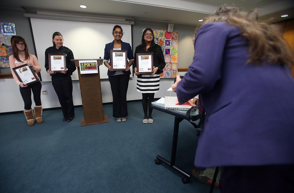 . **CQ** Maawa Alhafid, of Foothill High School in Pleasanton, Michelle Bostrom, of the Oakland Military Institute, Sharanya Stanley, of Dublin High School and  Niveditha Raghavan, of Amador Valley High School in Pleasanton, receive their awards during the Poetry Out Loud competition at the Alameda County Lakeside Plaza Building in Oakland, Calif., on Wednesday, Feb. 13, 2013.   (Jane Tyska/Staff)