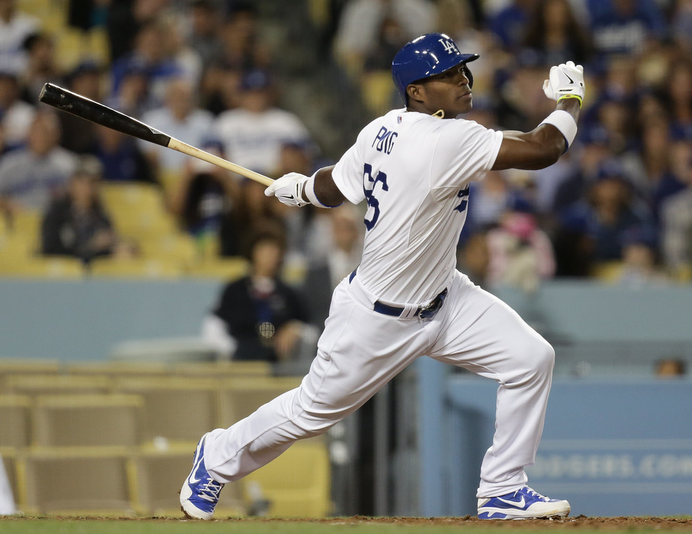 . Los Angeles Dodgers\' Yasiel Puig follows through on a two-run home run during the sixth inning of their baseball game against the San Diego Padres, Tuesday, June 4, 2013, in Los Angeles. (AP Photo/Jason Redmond)