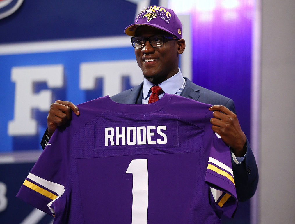 . Xavier Rhodes of the Florida State Seminoles holds up a jersey on stage after he was picked #25 overall by the Minnesota Vikings in the first round of the 2013 NFL Draft at Radio City Music Hall on April 25, 2013 in New York City.  (Photo by Al Bello/Getty Images)