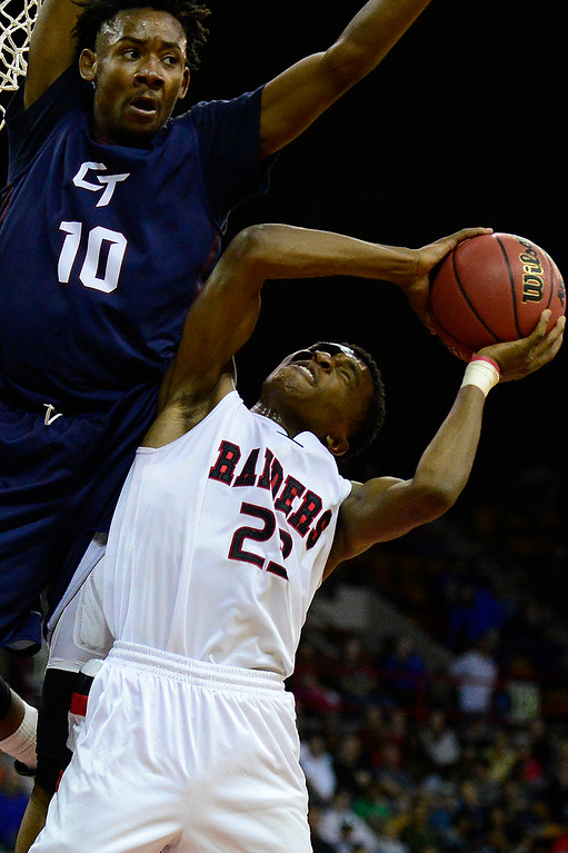 . Rangeview forward Elijah Reed (23) tries to move around the defense of Cherokee Trail forward David Thornton (10) during the second quarter at the Denver Coliseum on March 5, 2016 in Denver, Colorado. Rangeview defeated Cherokee Trail 75-64 to advance to the semifinals in the Class 5A Colorado state basketball tournament. (Photo by Brent Lewis/The Denver Post)