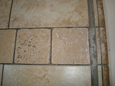 travertine detail in shower, pre-grout