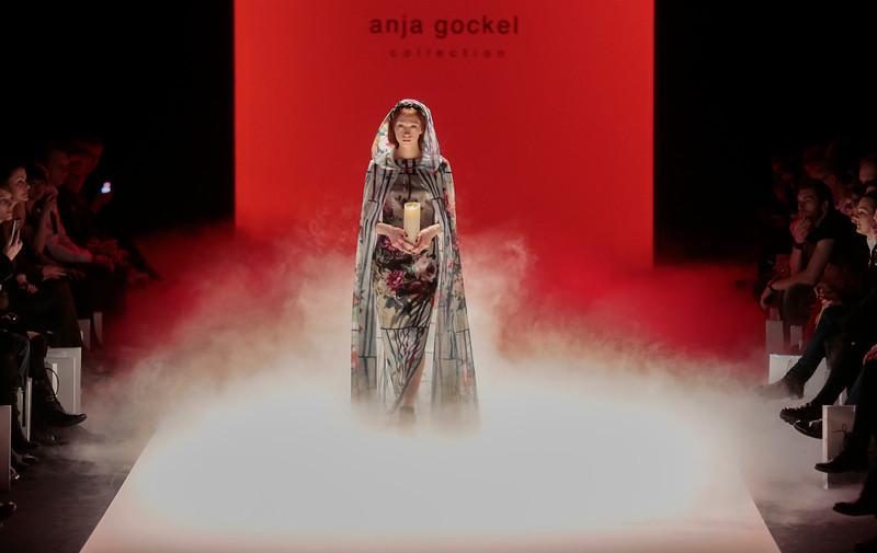 . A model presents a creation of Anja Gockel\'s Autumn Winter 2014 collection during the Mercedes Benz Fashion Week in Berlin, Wednesday, Jan. 15, 2014. (AP Photo/Markus Schreiber)