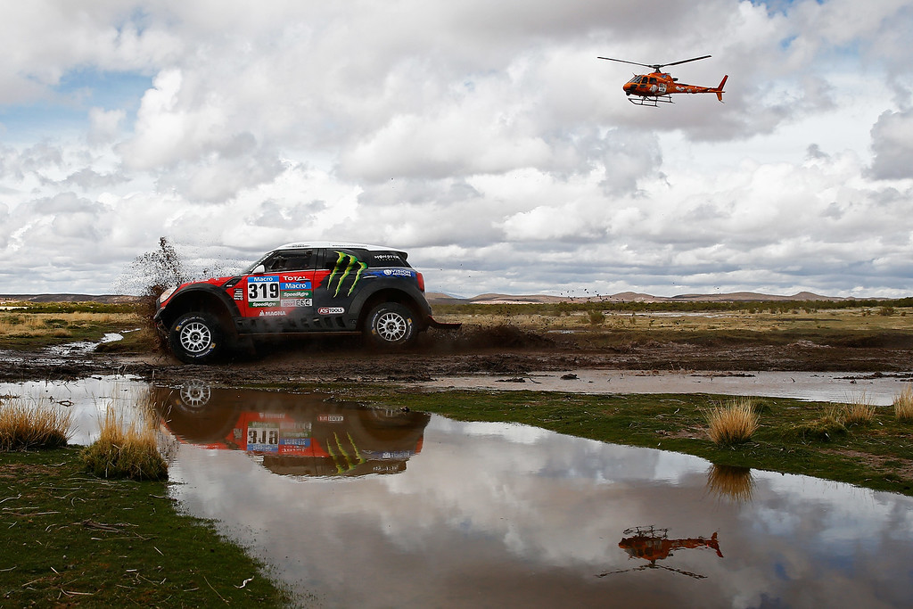 . ORURO, BOLIVIA - JANUARY 10:  #319 Boris Garafulic of Chile and Filipe Palmeiro of Portugal for X-Raid Team ALL4 Racing mini are followed by the TV helicopter during day 7 of the Dakar Rallly between Iquique in Chile and Uyuni in Bolivia on January 10, 2015 near Oruro, Bolivia.  (Photo by Dean Mouhtaropoulos/Getty Images)