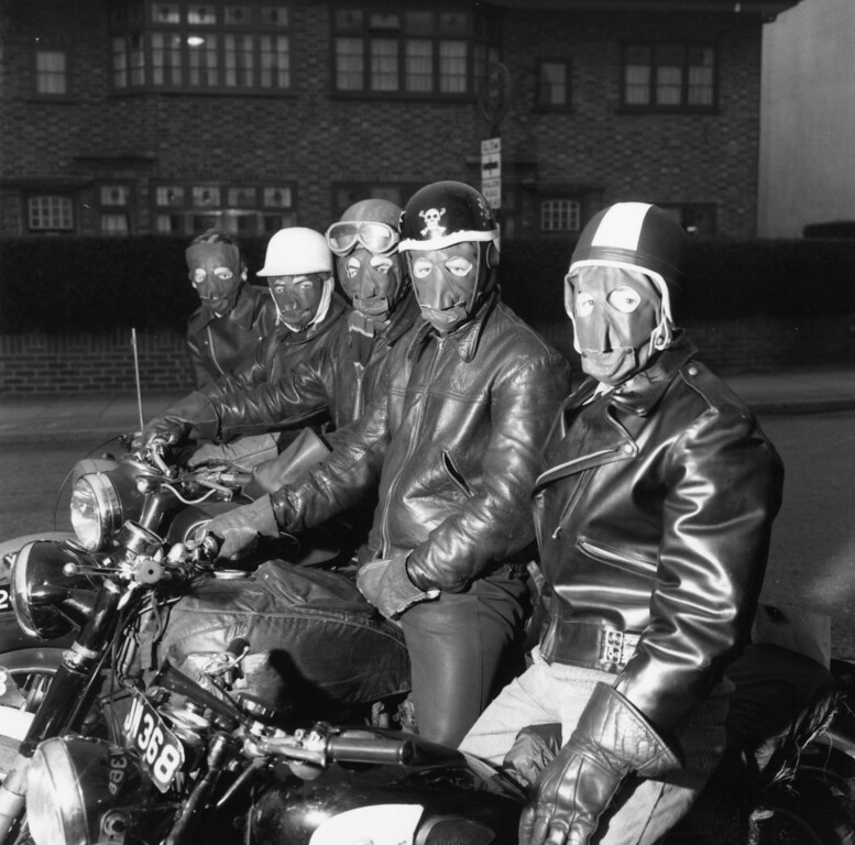 . March 1960:  A line of motorcyclists wearing leather masks and jackets.  (Photo by Frank Martin/BIPs/Getty Images)
