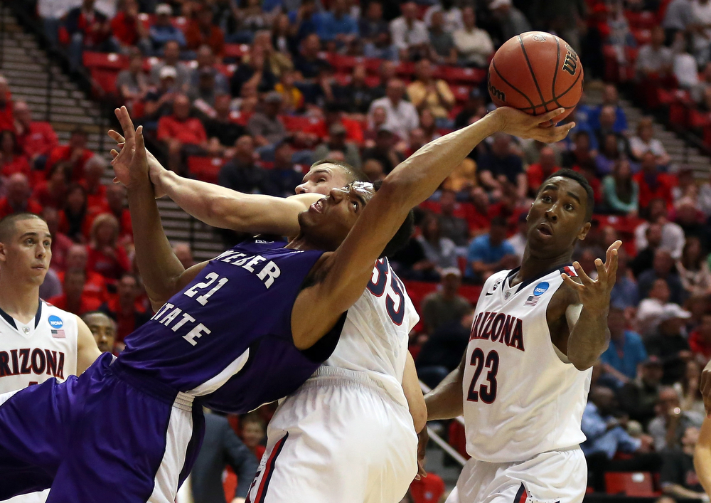 . Joel Bolomboy #21 of the Weber State Wildcats goes for a loose ball against Kaleb Tarczewski #35 and Rondae Hollis-Jefferson #23 of the Arizona Wildcats during the second round of the 2014 NCAA Men\'s Basketball Tournament at Viejas Arena on March 21, 2014 in San Diego, California.  (Photo by Jeff Gross/Getty Images)