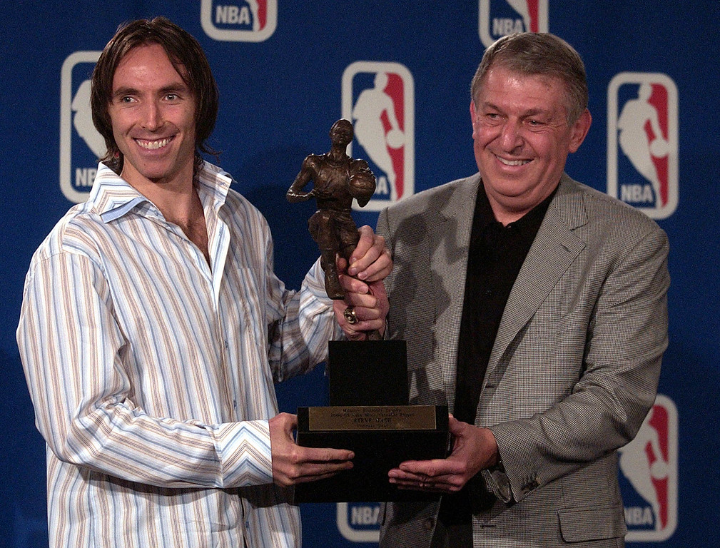 . Phoenix Suns chairman and CEO Jerry Colangelo, right, presents Suns guard Steve Nash, left, of Canada, with the NBA\'s Most Valuable Player Award for the 2004-05 season at a press conference at America West Arena in Phoenix Sunday, May 8, 2005. (AP Photo/Tom Hood)