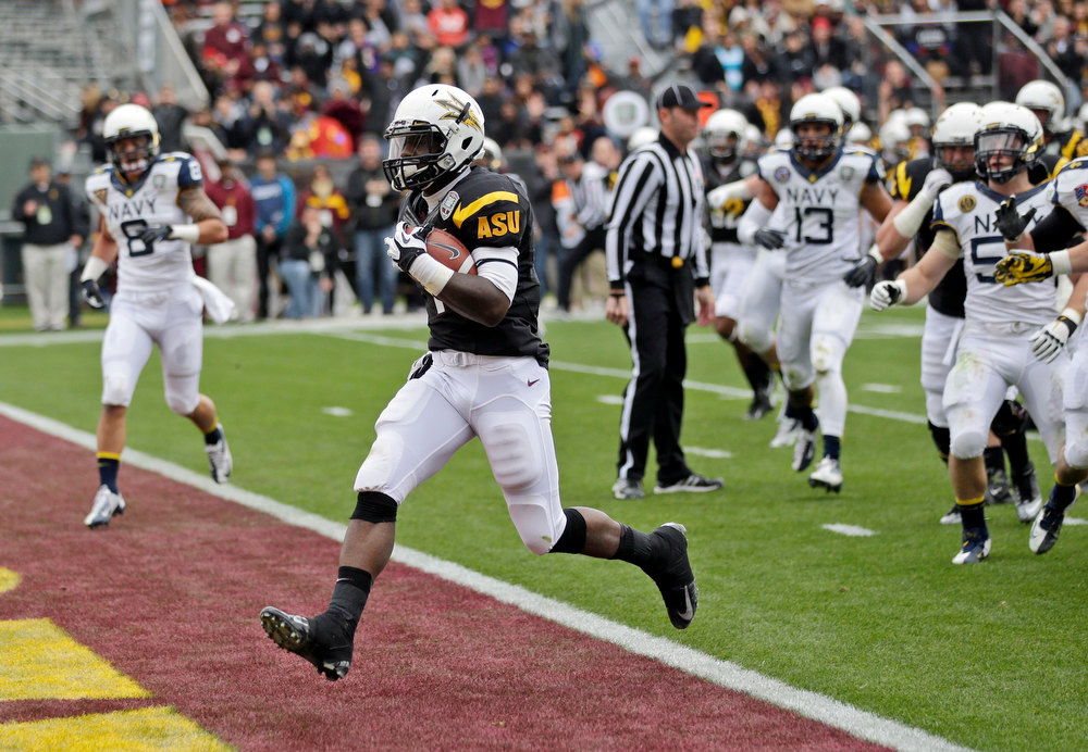 Description of . Arizona State running back Marion Grice, foreground, runs into the end zone on a 10-yard touchdown run against Navy during the first half of the Fight Hunger Bowl NCAA college football game in San Francisco, Saturday, Dec. 29, 2012. (AP Photo/Marcio Jose Sanchez)