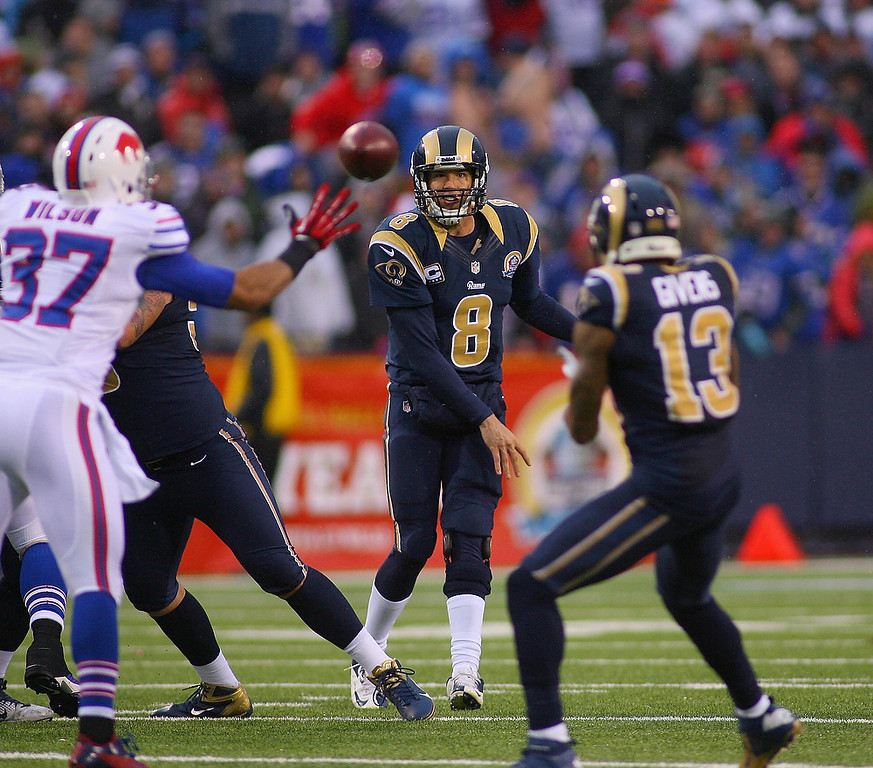 . Sam Bradford #8 of the St. Louis Rams throws a pass to  Chris Givens #13 against the Buffalo Bills at Ralph Wilson Stadium on December 9, 2012 in Orchard Park, New York.St Louis won 15-12.  (Photo by Rick Stewart/Getty Images)