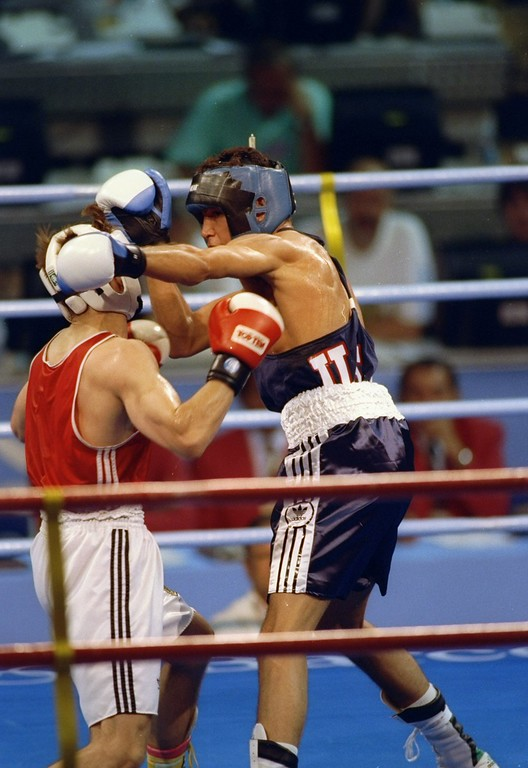 . 1992:  Oscar De La Hoya throws a punch at Marc Rugolfn during the Olympic Games in Barcelona, Spain. Mandatory Credit: Mike Powell  /Allsport