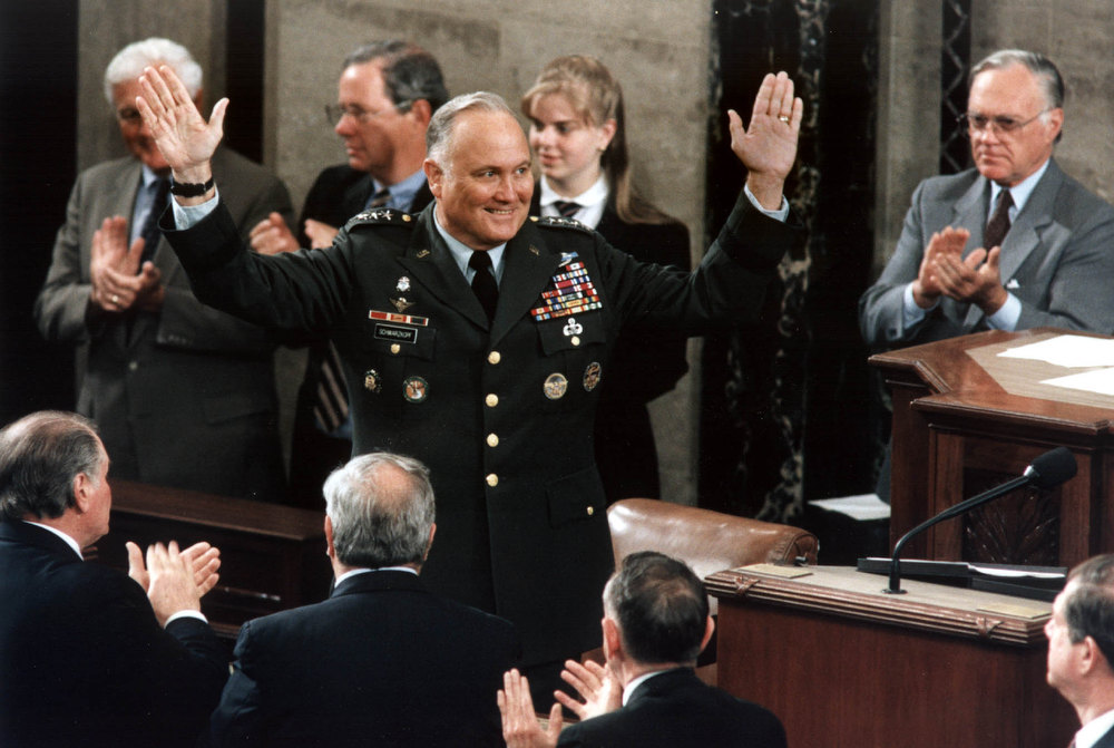 Description of . General Norman Schwarzkopf, commander of Operation Desert Storm, is given a standing ovation 08 May 1991, Washington,DC in the House of Representative chamber, where he was honored by members of Congress. Schwarzkopf thanked the Congress and the American people for their support during the war. KEVIN LARKIN/AFP/Getty Images
