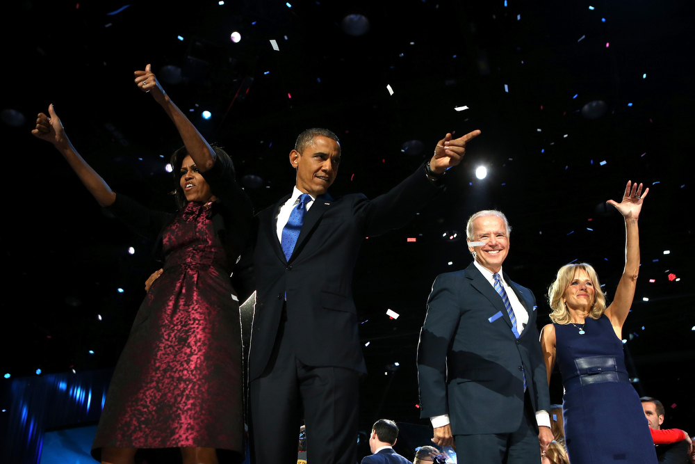 Description of . U.S. President Barack Obama stands on stage with first lady Michelle Obama, U.S. Vice President Joe Biden and Dr. Jill Biden after his victory speech on election night at McCormick Place November 6, 2012 in Chicago, Illinois. Obama won reelection against Republican candidate, former Massachusetts Governor Mitt Romney.  (Photo by Chip Somodevilla/Getty Images)