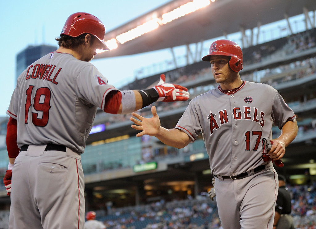 . MINNEAPOLIS, MN - SEPTEMBER 9: Collin Cowgill #19 of the Los Angeles Angels of Anaheim congratulates teammate Chris Iannetta #17 on scoring a run against the Minnesota Twins during the fourth inning of the game on September 9, 2013 at Target Field in Minneapolis, Minnesota. (Photo by Hannah Foslien/Getty Images)