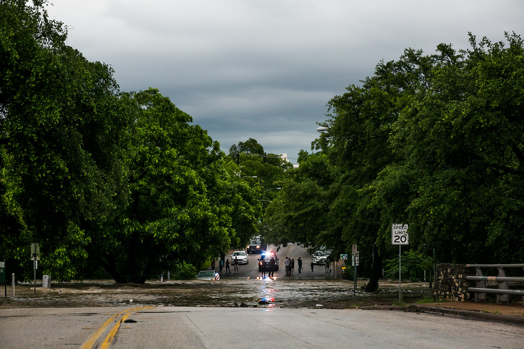 . AUSTIN, TX - MAY 25:   A street is shown partially submerged after days of heavy rain on May 25, 2015 in Austin, Texas. Texas Gov. Greg Abbott toured the damage zone where one person is confirmed dead and at least 12 others missing in flooding along the Rio Blanco, which reports say rose as much as 40 feet in places, caused by more than 10 inches of rain over a four-day period. The governor earlier declared a state of emergency in 24 Texas counties.  (Photo by Drew Anthony Smith/Getty Images)