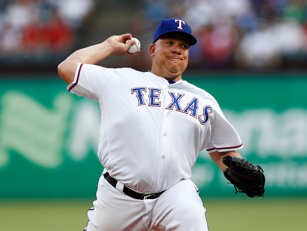 . Texas Rangers starting pitcher Bartolo Colon delivers to a Cleveland Indians batter during the first inning of a baseball game, Saturday, July 21, 2018, in Arlington, Texas. (AP Photo/Jim Cowsert)