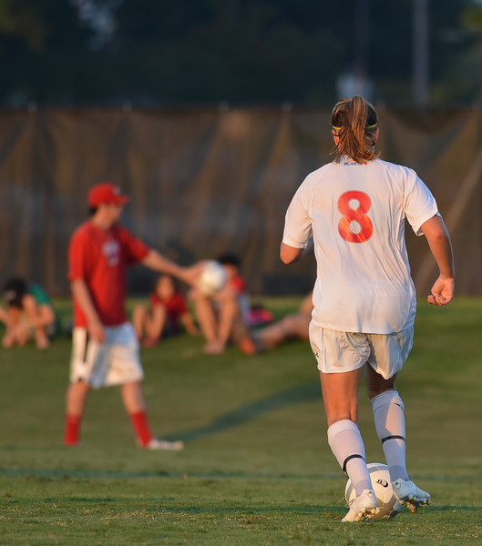 Megan Curan dribble's the ball down the field towards the goal.