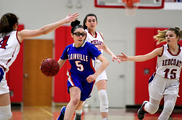 2/26/2019 Mike Orazzi | Staff Plainville's Jaida Vasquez (5) during the CIAC 2019 State Girls Basketball Tournament at Berlin High School Tuesday night.