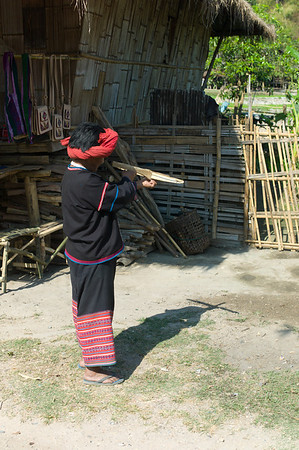 """Hand-made cross bow demonstrated by resident of The Hilltribe People of Thailand.  The Karen, Mien, Hmong, Lahu, Akha and Lisu... A 2,000 Year Journey to the Thai Payap.  Hilltribe People can trace their origin from the southern Sino-Tibetan geographical area. Though all have legends that speak of their particular tribe as being the """"original people"""" of this area, it is more practical to think of them as part of a continuing exodus of ancient peoples out of China as far back as 2,000 years.  Their history is shrouded in myth and legend; a beginning as hazy and dim as the early morning mist that cloaks their valleys. Depending on the source of the information, most of the Hilltribesmen came from the interior of southern China. These semi-nomadic peoples moved slowly, driven by their need for new land to replace that exhausted by their slash and burn farming techniques. They eventually arrived on the northern borderlands of Thailand, called the Payap.  The gentle tribal people that occupy the lush hillsides and verdant valleys of the Payap, a section now called the Golden Triangle, have come from the south-west and south-central areas of China. All, that is, except the Karen: their origin remains one of conjecture and debate. All of the Hilltribes retain various aspects of their Chinese cultural heritage however the Karen seem to have a cultural background in common with the people of Tibet.  For the most part tribes still remain concentrated on the northern borders of Thailand but with the passage of time increased internal migration has gone as far south as Bangkok. It is now impossible to outline distinct areas of a particular tribe's district. Some places you may find all six major Hilltribes living on the same mountain side or valley.  There is a cultural tendency for the earliest tribes, like the Karen, to have ventured into Siam and lowland valleys. Other tribes, like the Hmong, moved into the more mountainous regions of the borderlands of the Payap. All of the"""