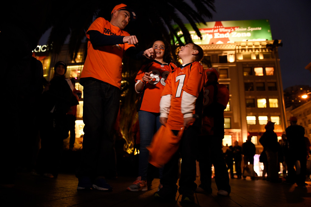 . SAN FRANCISCO, CA - FEBRUARY 03: Matt Gomes and his daughter Matison trying to get an  end zone dance out of his son Marcus 6, at a Broncos fan gathering in Union Square with the Broncos Cheerleaders and Miles the Mascot, San Francisco, CA. February 03, 2016 (Photo by Joe Amon/The Denver Post)