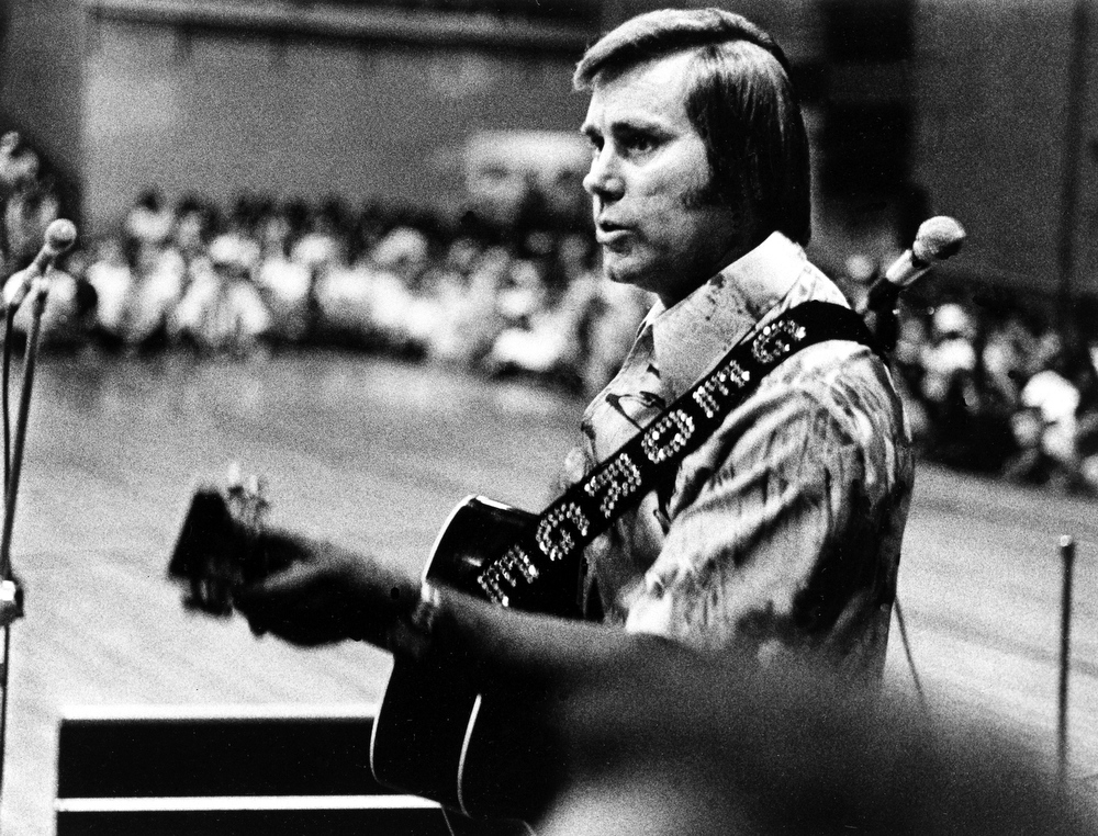 ". FILE - In this undated photo, Country singer George Jones is shown performing with his guitar.  Jones, the peerless, hard-living country singer who recorded dozens of hits about good times and regrets and peaked with the heartbreaking classic ""He Stopped Loving Her Today,\"" has died. He was 81. Jones died Friday, April 26, 2013 at Vanderbilt University Medical Center in Nashville after being hospitalized with fever and irregular blood pressure, according to his publicist Kirt Webster. (AP Photo, File)"