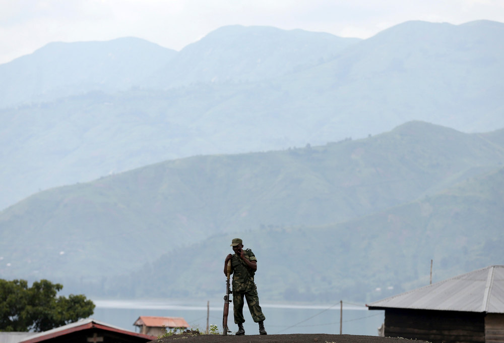 . A government army FARDC soldier stands in the town of Sake, some 27 km (17 miles) west of Goma December 3, 2012. REUTERS/Goran Tomasevic