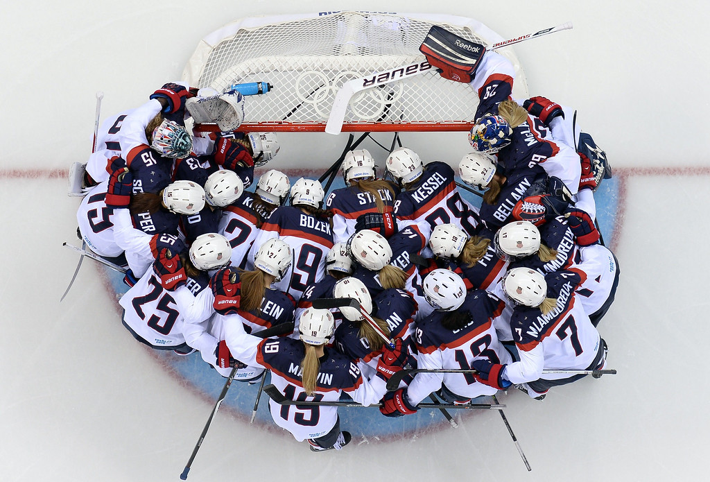 . USA\'s players gather before the start of the Women\'s Ice Hockey Group A match between Canada and USA at the Sochi Winter Olympics on February 12, 2014 at the Shayba Arena. JONATHAN NACKSTRAND/AFP/Getty Images