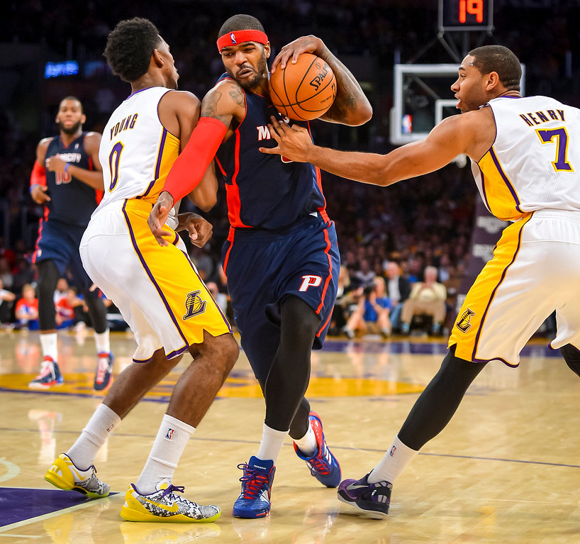 . Detroit�s Josh Smith tries to get through Lakers� Nick Young and Xavier Henry during second half action at Staples Center Sunday, November 17, 2013.  The Lakers defeated the Detroit Pistons 114-99.  ( Photo by David Crane/Los Angeles Daily News )