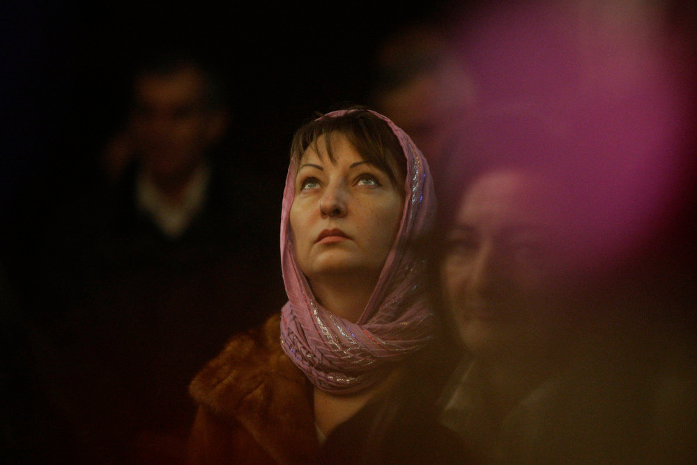 . Bosnian Orthodox Serbs, attend Christmas Mass in Orthodox Church in Tuzla, 70 kms north of Sarajevo, early morning, Monday, Jan. 7, 2013. Orthodox Christians celebrate Christmas day on January 7 as they follow the Julian Calendar, which was replaced in Western Europe by the Gregorian calendar 500 years ago. (AP Photo/Amel Emric)