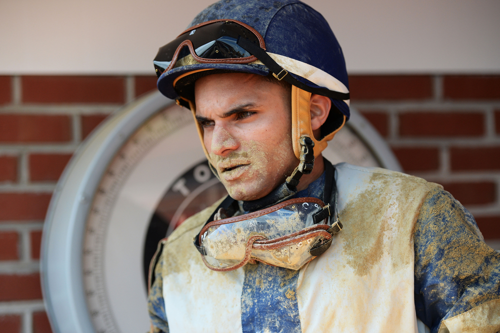 . A jockey is weighed after a race prior to the 139th running of the Preakness Stakes at Pimlico Race Course on May 17, 2014 in Baltimore, Maryland.  (Photo by Patrick Smith/Getty Images)