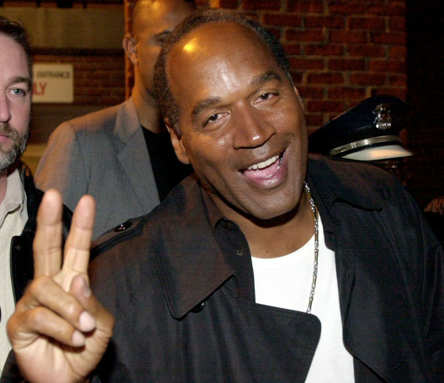 ". 6. (tie) O.J. SIMPSON <p>Mulling conversion to Islam, 20 years after the honor killing of his ex-wife. (unranked) </p><p><b><a href=""http://blacksportsonline.com/home/2014/08/oj-simpson-converting-to-islam-wants-to-be-a-muslim/\"" target=\""_blank\""> LINK </a></b> </p><p>   (Mike Simons/Getty Images)</p>"