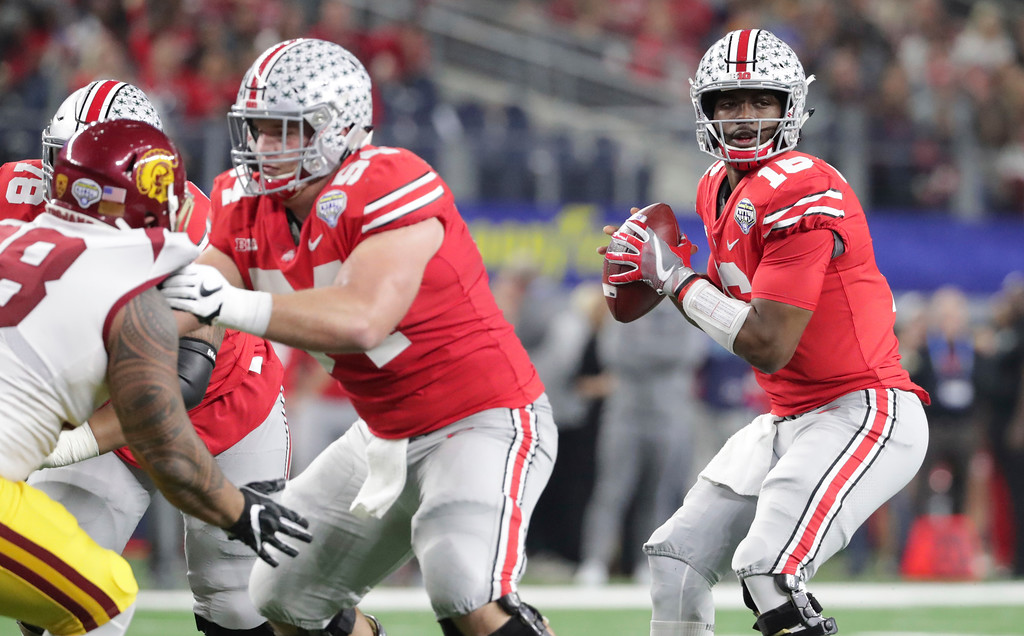 . Ohio State quarterback J.T. Barrett (16) looks to pass as offensive lineman Billy Price (54) blocks Southern California defensive tackle Josh Fatu (98) during the first half of the Cotton Bowl NCAA college football game in Arlington, Texas, Friday, Dec. 29, 2017. (AP Photo/LM Otero)
